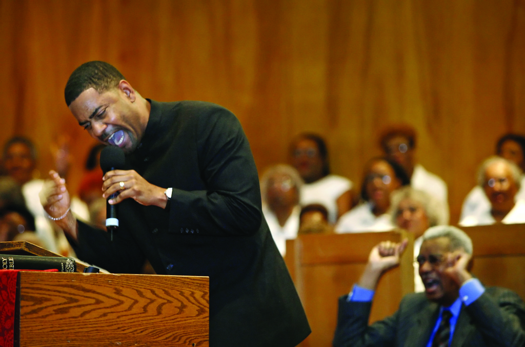 For Diana Keough Story -- Left, Rev. Otis Moss, III preaches during the annual revival at Olivet Institutional Baptist Church in Cleveland while his father, Pastor Otis Moss, Jr. sits behind him. March 21, 2007 (Lonnie Timmons III/Plain Dealer)